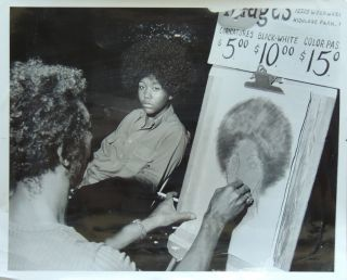 July 23-24, 1972 Press Photograph of a teenage African-American girl sitting for an...